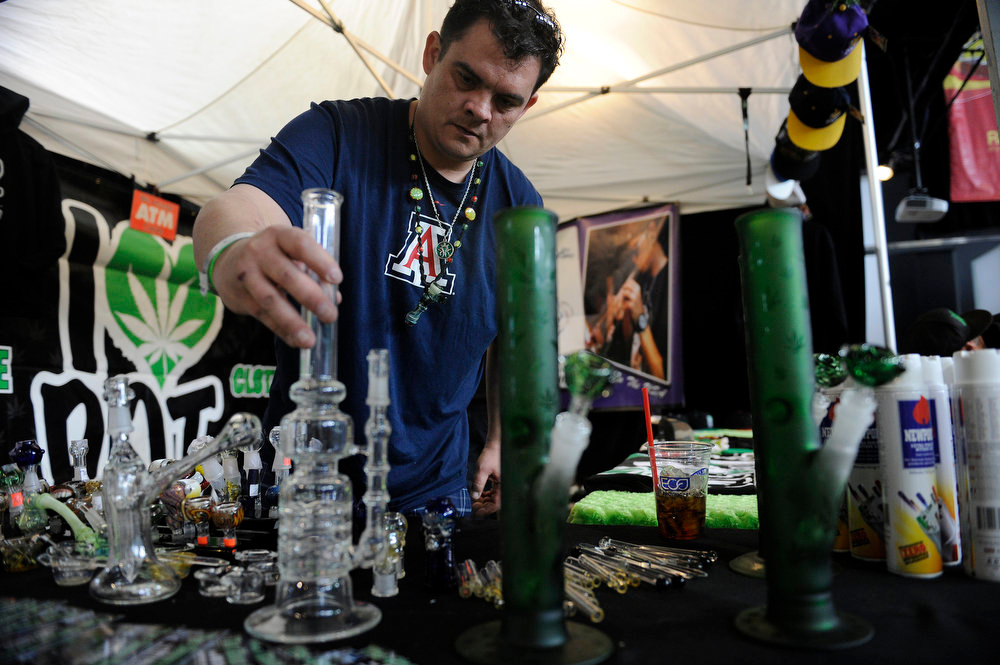 . Jeff Dahlen of the Glass Bottom shop arranges pipes and bongs for display before doors opened during the final day of the first ever High Times US Cannabis Cup at the Exdo Center in Denver on Sunday, April 21, 2013. Seth A. McConnell, The Denver Post