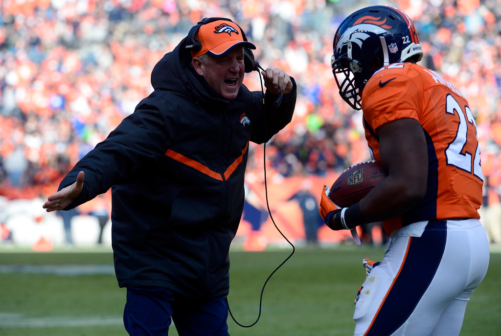 . DENVER, CO - DECEMBER 28: C.J. Anderson (22) of the Denver Broncos celebrates with head coach John Fox of the Denver Broncos after scoring Denver\'s first touchdown of the game in the first quarter.  The Denver Broncos played the Oakland Raiders at Sports Authority Field at Mile High in Denver on December, 28 2014. (Photo by Tim Rasmussen/The Denver Post)