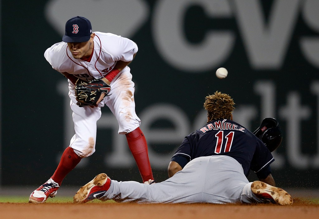 . Cleveland Indians\' Jose Ramirez (11) steals second base as the throw gets by Boston Red Sox\'s Ian Kinsler during the seventh inning of a baseball game in Boston, Tuesday, Aug. 21, 2018. (AP Photo/Michael Dwyer)