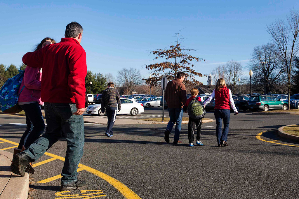 . Families walk to their cars after picking up students from Reed Intermediate School in Newtown, Connecticut, following a shooting nearby at Sandy Hook Elementary School, December 14, 2012. A heavily armed gunman opened fire on school children and staff at a Connecticut elementary school on Friday, killing 26 people including 18 children in the latest in a series of shooting rampages that have tormented the United States this year, U.S. media reported. REUTERS/Lucas Jackson
