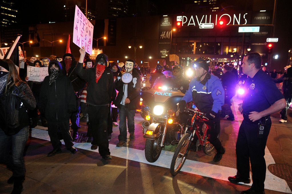 . DENVER, CO. - NOVEMBER 5: Two hundred protesters calling themselves Anonymous tied up traffic in downtown Denver Tuesday night, November 5, 2013.  Many of the protesters wore masks to mark Guy Fawkes Day. Photo By Karl Gehring/The Denver Post
