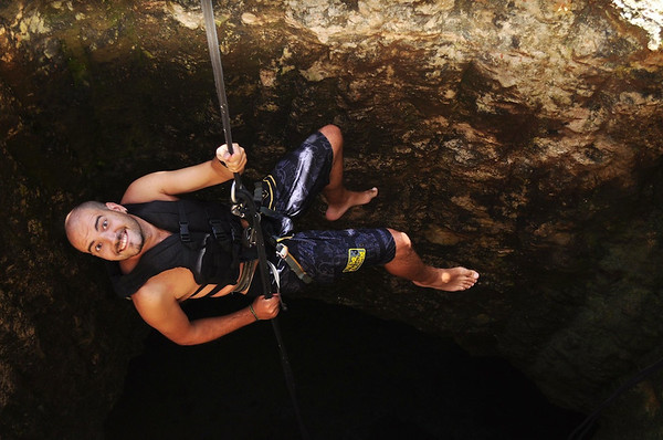 Alberto abseiling in Riviera Maya, Mexico adventure travel blogger