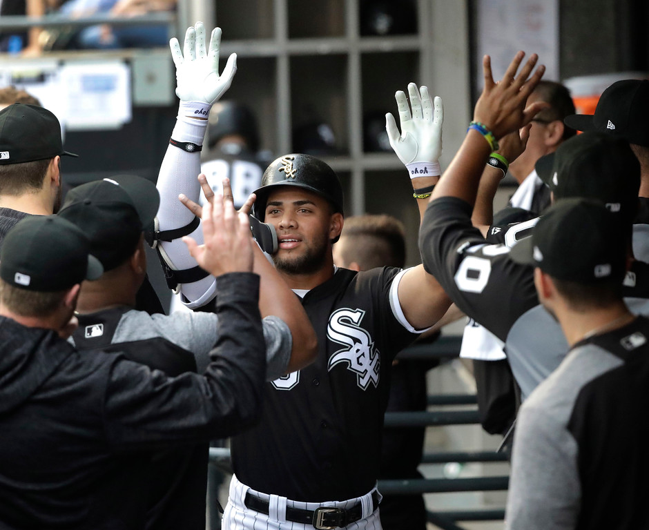 . Chicago White Sox\'s Yoan Moncada celebrates his home run off Cleveland Indians starting pitcher Adam Plutko during the first inning of a baseball game Tuesday, June 12, 2018, in Chicago. (AP Photo/Charles Rex Arbogast)