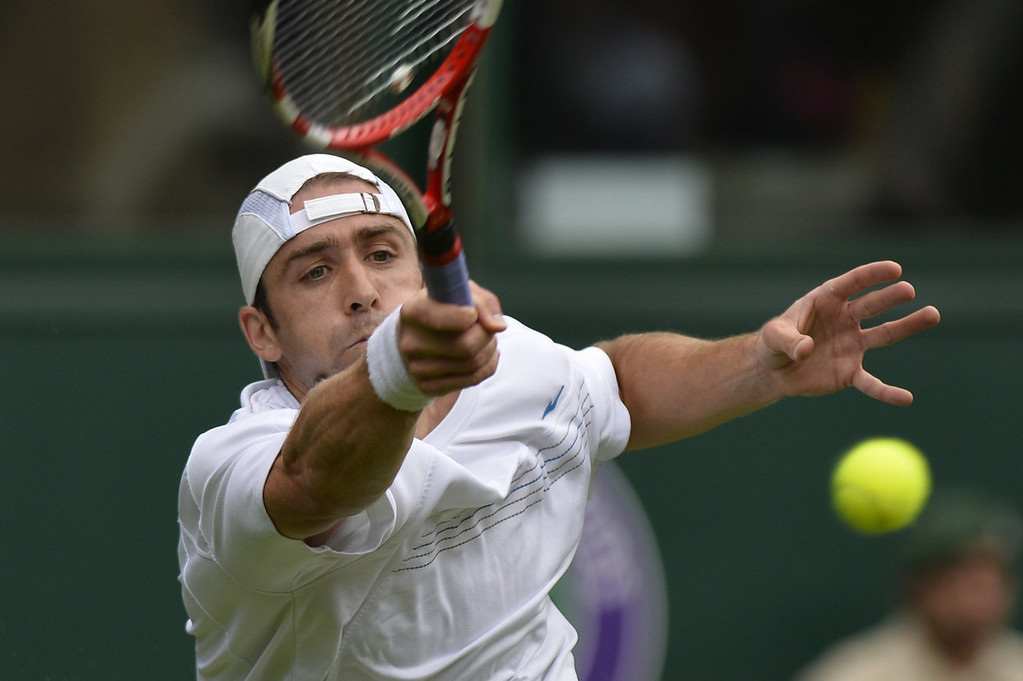. Germany\'s Benjamin Becker returns against Britain\'s Andy Murray during their men\'s first round match on day one of the 2013 Wimbledon Championships tennis tournament at the All England Club in Wimbledon, southwest London, on June 24, 2013.  ADRIAN DENNIS/AFP/Getty Images