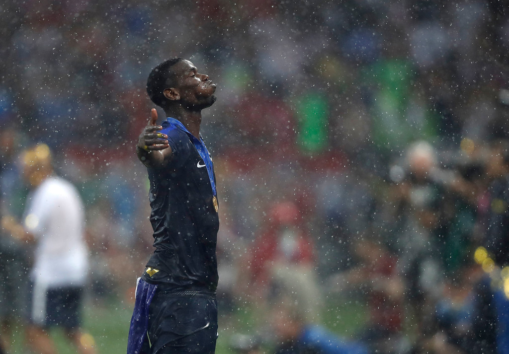 . France\'s Paul Pogba poses for the cameras after France defeated Croatia in the final match between France and Croatia at the 2018 soccer World Cup in the Luzhniki Stadium in Moscow, Russia, Sunday, July 15, 2018. France won the game 4-2. (AP Photo/Francisco Seco)