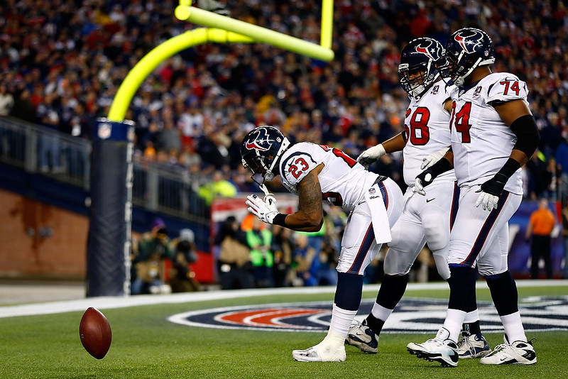 . Arian Foster #23 of the Houston Texans celebrates after scoring a touchdown in the second quarter against the New England Patriots during the 2013 AFC Divisional Playoffs game at Gillette Stadium on January 13, 2013 in Foxboro, Massachusetts.  (Photo by Jared Wickerham/Getty Images)
