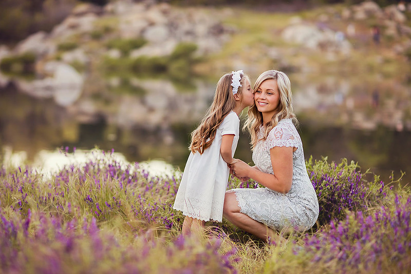Sacramento family photographer during outdoor portrait session. Mother and daughter picture at a park.