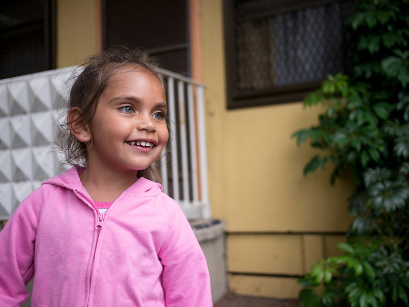 This photo shows a three-year-old Aboriginal girl in an urban setting in the Greater City of Melbourne, Australia.  The photo was made in a housing estate.
