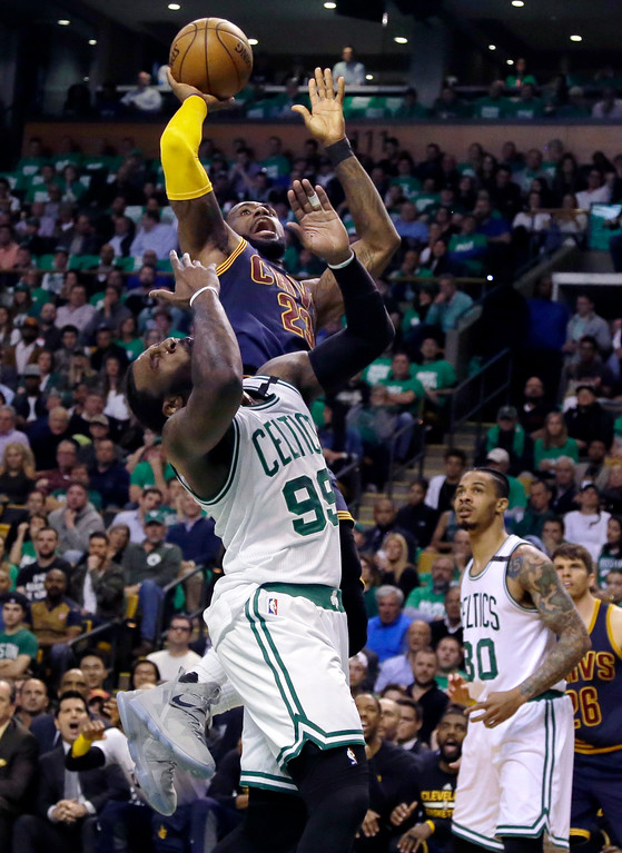 . Cleveland Cavaliers forward LeBron James, top, shoots over Boston Celtics forward Jae Crowder during the first half of Game 5 of the NBA basketball Eastern Conference finals, on Thursday, May 25, 2017, in Boston. (AP Photo/Elise Amendola)