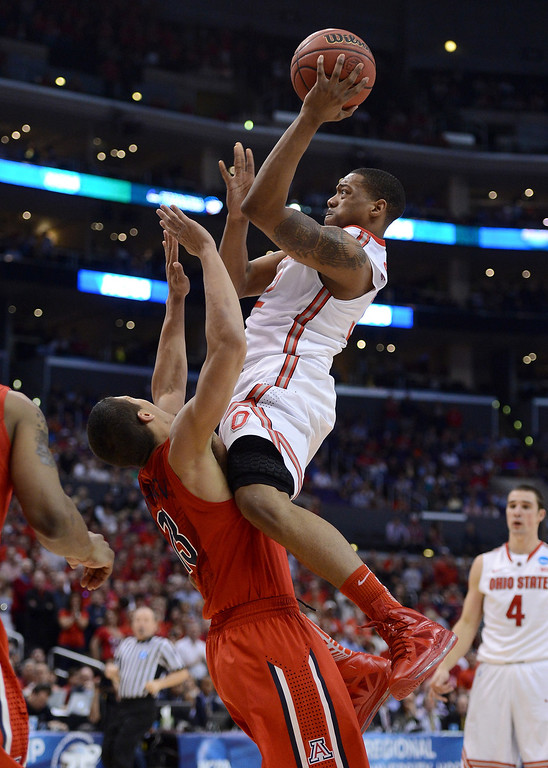 . Lenzelle Smith, Jr. #32 of the Ohio State Buckeyes goes up for a shot as Nick Johnson #13 of the Arizona Wildcats is called for a block in the second half during the West Regional of the 2013 NCAA Men\'s Basketball Tournament at Staples Center on March 28, 2013 in Los Angeles, California.  (Photo by Harry How/Getty Images)