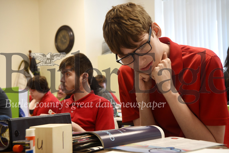 Butler High School student Paul Fundark, 18, looks through a magazine for images to use on his vision board. Photos by Gabriella Canalas