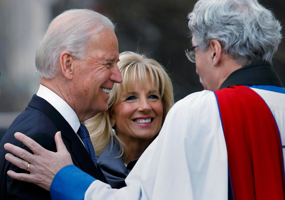Description of . U.S. Vice President Joe Biden (L) and his wife, Dr. Jill Biden, talk with Reverend Luis Leon outside St. John's Church prior to inauguration ceremonies in Washington, January 21, 2013. REUTERS/Joe Skipper