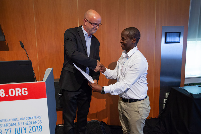 The Netherlands, Amsterdam, 24-7-2018. Prize beingh handed, Strategies For CurePhoto: Rob Huibers for IAS.(Please publish always with complete attribution).