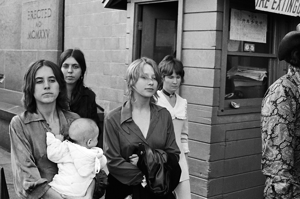 ". Young women who identified themselves as members of the Charles Manson ""family\"" leave a Los Angeles courtroom where the hippie-style cult leader pleaded innocent to charges of murdering actress Sharon Tate and six others, on Jan. 29, 1970.  Some members of the group gave newsmen their names as Gypsy, Cappy and Squeaky.  (AP Photo)"