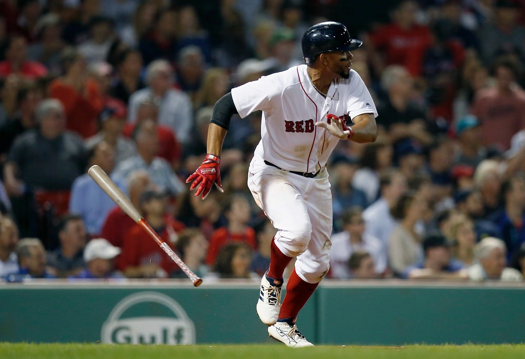 . Boston Red Sox\'s Xander Bogaerts runs on his two-run double during the seventh inning of a baseball game against the Cleveland Indians in Boston, Tuesday, Aug. 21, 2018. (AP Photo/Michael Dwyer)