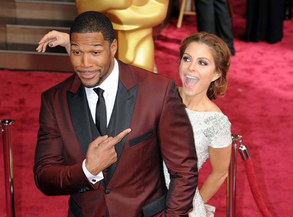 . Michael Strahan (L) and Maria Menounos attend the 86th Academy Awards at the Dolby Theatre in Hollywood, California on Sunday March 2, 2014 (Photo by John McCoy / Los Angeles Daily News)