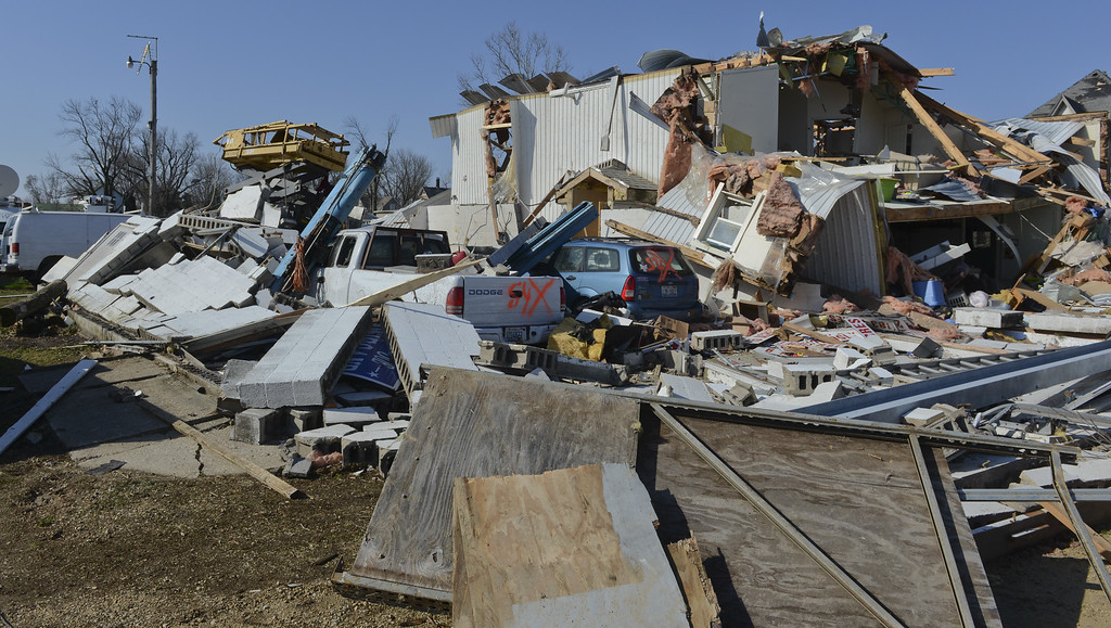 . Storm damage and debris cover the ground on Friday, April 10, 2015, following a tornado that hit the town of Fairdale, Ill., Thursday night killing one person. The National Weather Service says at least two tornadoes churned through six north-central Illinois counties. (AP Photo/Matt Marton)