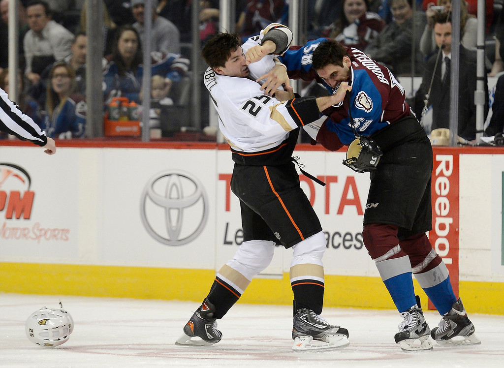 . DENVER, CO. - FEBRUARY 06: Patrick Bordeleau (58) of the Colorado Avalanche and Brad Staubitz (25) of the Anaheim Ducks fight during the first period February 6, 2013 at Pepsi Center. The Colorado Avalanche take on the  Anaheim Ducks in NHL action. (Photo By John Leyba / The Denver Post)