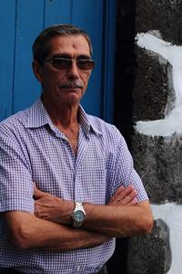 José Edvíno da Silveira (Salão, Faial), born 1942, pictured outside the old mess hall near the Salão harbor. July 25, 2012.