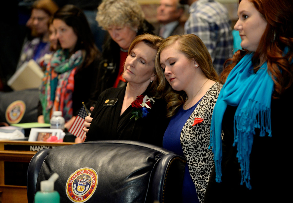 . DENVER, CO. - JANUARY 08: (l-r) Senator Linda Newell stands in prayer with her daughters Brittany and Kate during the opening of the first day of the new legislative session at the Colorado Capitol in Denver, CO January 08, 2014. (Photo By Craig F. Walker / The Denver Post)