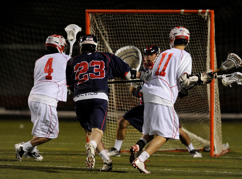 . AURORA, CO. - APRIL 24:  Regis attack Chet Dunstan (4) had an open shot right in front of the net in the second half. The Regis Jesuit High School boy\'s lacrosse team defeated Kent Denver 10-8 Wednesday night, April 24, 2013. Photo By Karl Gehring/The Denver Post