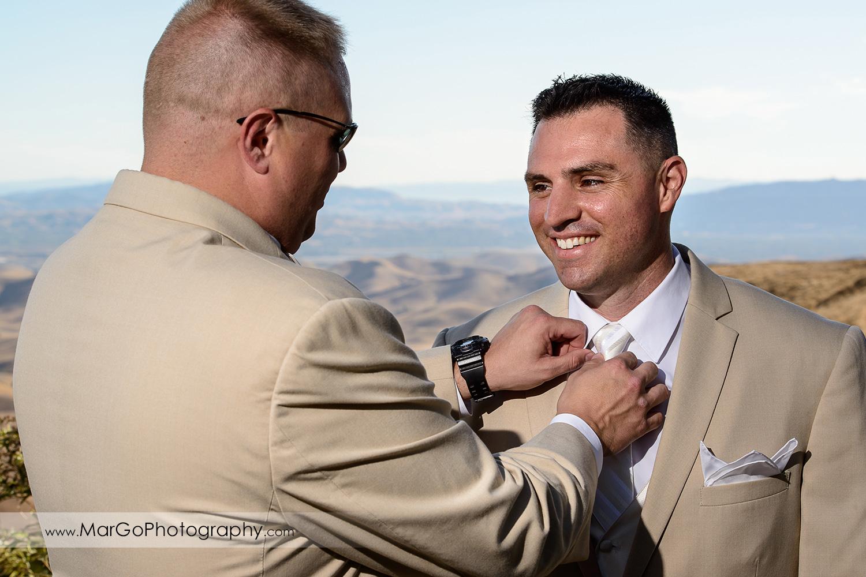 best man fixing groom's tie