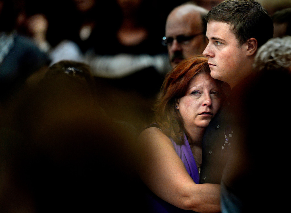 ". Theresa Hoover holds her son, Wil Boik, 22, during the funeral of her younger son, AJ Boik, 18, on Friday, July 27, 2012 at the Queen of Peace Catholic Church in Aurora. ""And all I want to do is just hug him, and I know I can\'t,\"" she said. Joe Amon, The Denver Post"