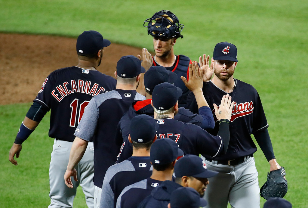 . Cleveland Indians starting pitcher Corey Kluber, right, high-fives teammates after closing out a baseball game against the Baltimore Orioles in Baltimore, Monday, June 19, 2017. Cleveland won 12-0. (AP Photo/Patrick Semansky)