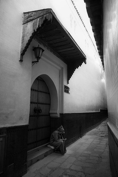 A beggar in the narrow streets of the old medina.   Fez, Morocco, 2018.
