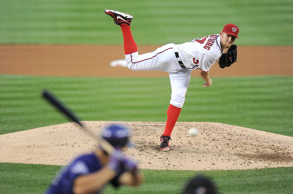 . Stephen Strasburg #37 of the Washington Nationals pitches in the fifth inning against the Colorado Rockies at Nationals Park on June 21, 2013 in Washington, DC.  (Photo by Greg Fiume/Getty Images)
