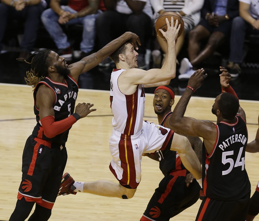 . Miami Heat guard Goran Dragic (7) attempts to score as Toronto Raptors forward DeMarre Carroll (5) defends, in overtime during Game 4 of an NBA second-round playoff basketball series, Monday, May 9, 2016, in Miami. The Heat defeated the Raptors 94-87 in overtime. The series is tied 2-2. (AP Photo/Alan Diaz)