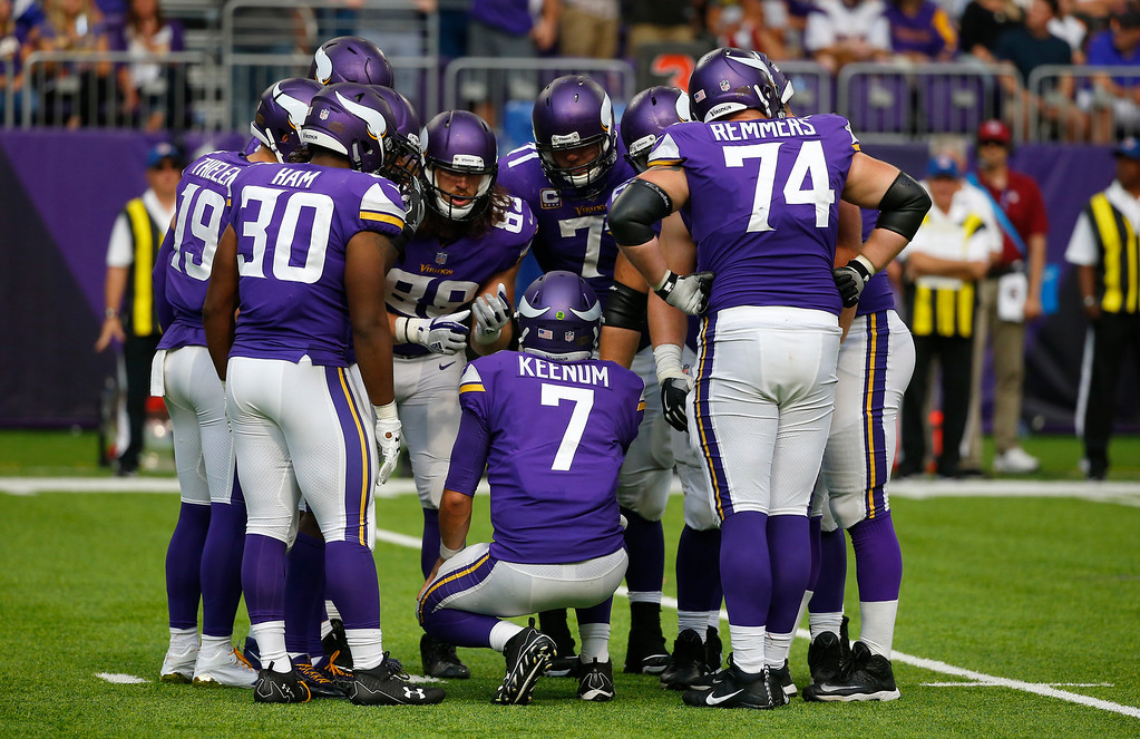 . Minnesota Vikings quarterback Case Keenum (7) calls a play in the huddle during the second half of an NFL football game against the Tampa Bay Buccaneers, Sunday, Sept. 24, 2017, in Minneapolis. The Vikings won 34-17. (AP Photo/Bruce Kluckhohn)