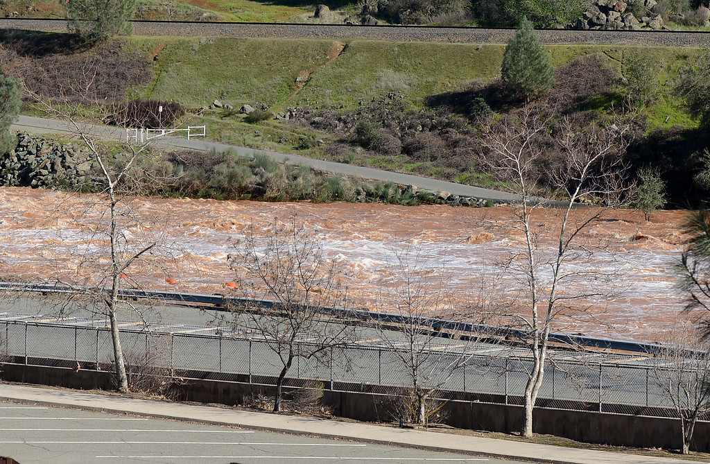 . A muddy Feather River flows Saturday, Feb. 11, 2017, in Oroville, California. (Dan Reidel -- Enterprise-Record)
