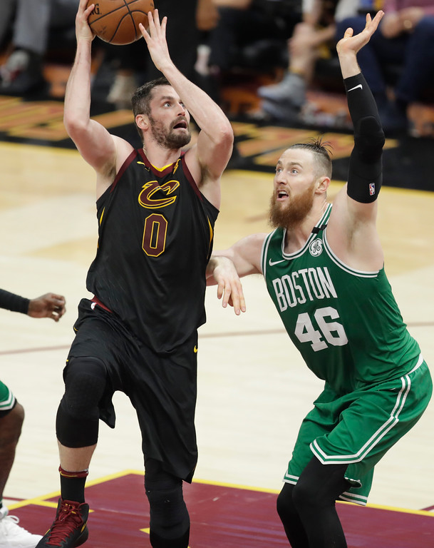 . Cleveland Cavaliers\' Kevin Love (0) shoots over Boston Celtics\' Aron Baynes (46), from Australia, in the second half of Game 3 of the NBA basketball Eastern Conference finals, Saturday, May 19, 2018, in Cleveland. (AP Photo/Tony Dejak)