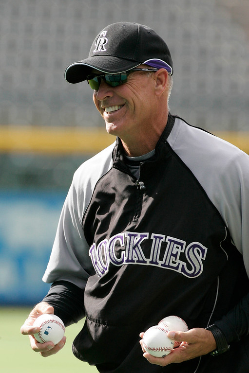 . Colorado Rockies manager Jim Tracy throws batting practice before a baseball game with the San Diego Padres in Denver, Colo., Friday, May 29, 2009. Tracy replaced Clint Hurdle. (AP Photo/Will Powers)