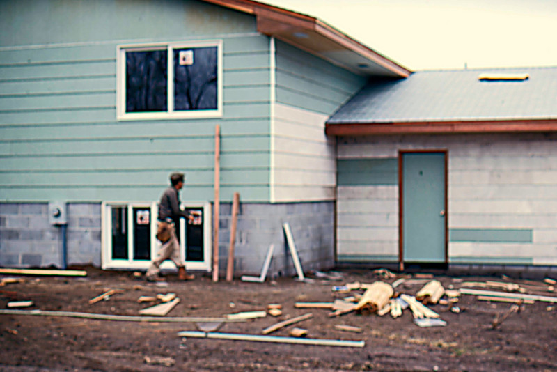 1974-10 - Carpenter at back side of house