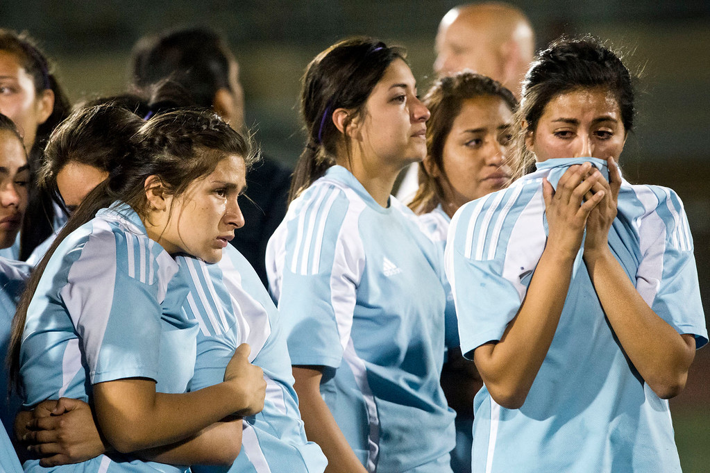 . Arroyo High players react after being defeated by Marshall High in the CIF soccer championship game at Warren High School in Downey on Friday night, March 1, 2013. Marshall won 2-0. (SGVN/Staff photo by Watchara Phomicinda)