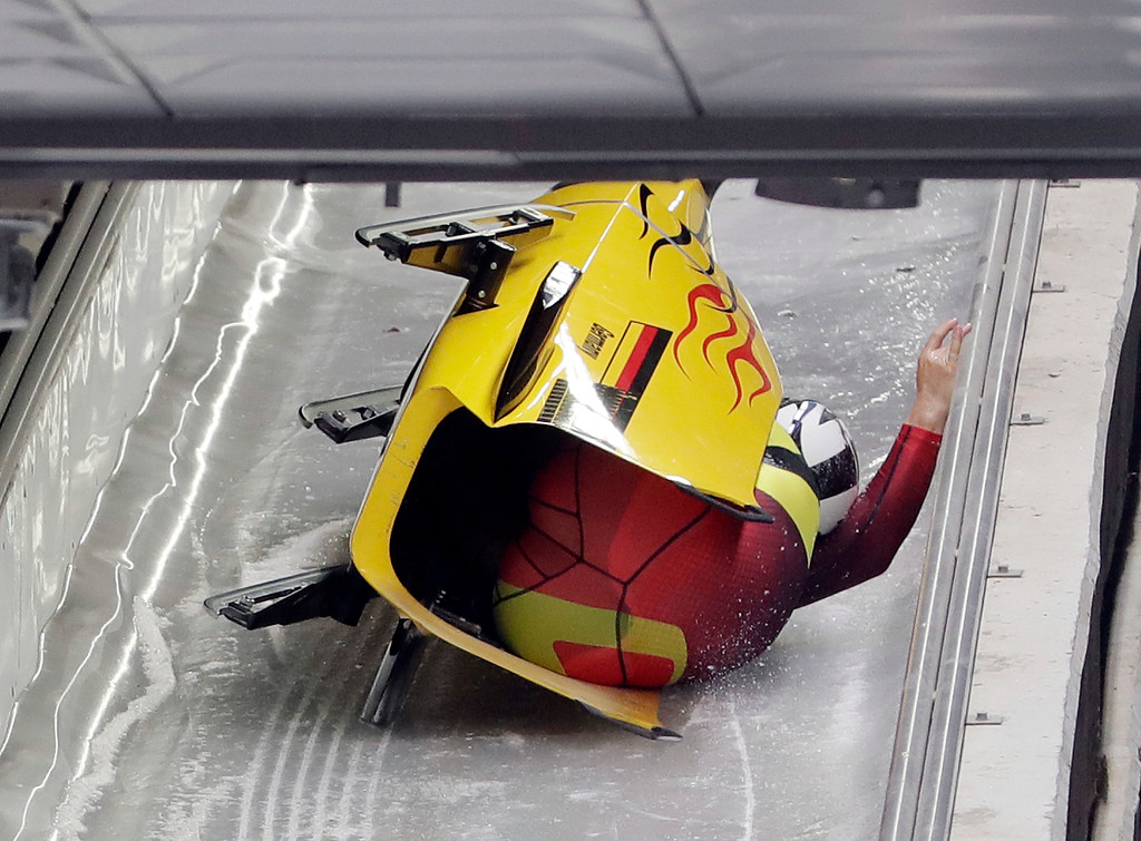 . Driver Nico Walther and Christian Poser of Germany crash in the finish area after the second run during the two-man bobsled competition at the 2018 Winter Olympics in Pyeongchang, South Korea, Sunday, Feb. 18, 2018. (AP Photo/Michael Sohn)
