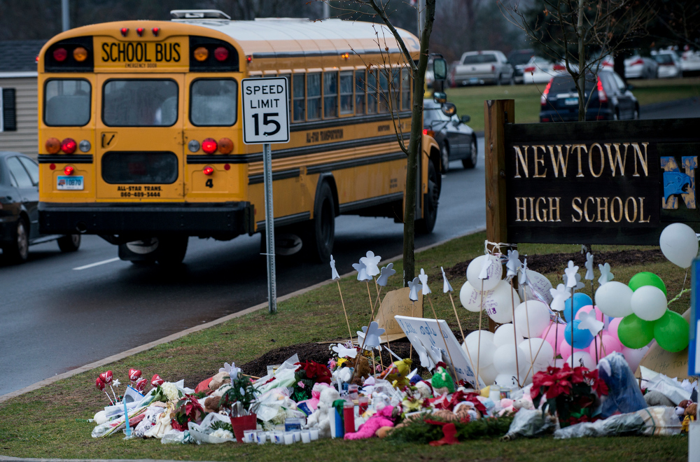 Description of . A school bus passes a makeshift memorial to the victims of the Sandy Hook Elementary School shooting as it takes students to Newtown High School December 18, 2012 in Newtown, Connecticut. Students in Newtown, excluding Sandy Hook Elementary School, return to school for the first time since last Friday's shooting at Sandy Hook which took the live of 20 students and 6 adults.  BRENDAN SMIALOWSKI/AFP/Getty Images