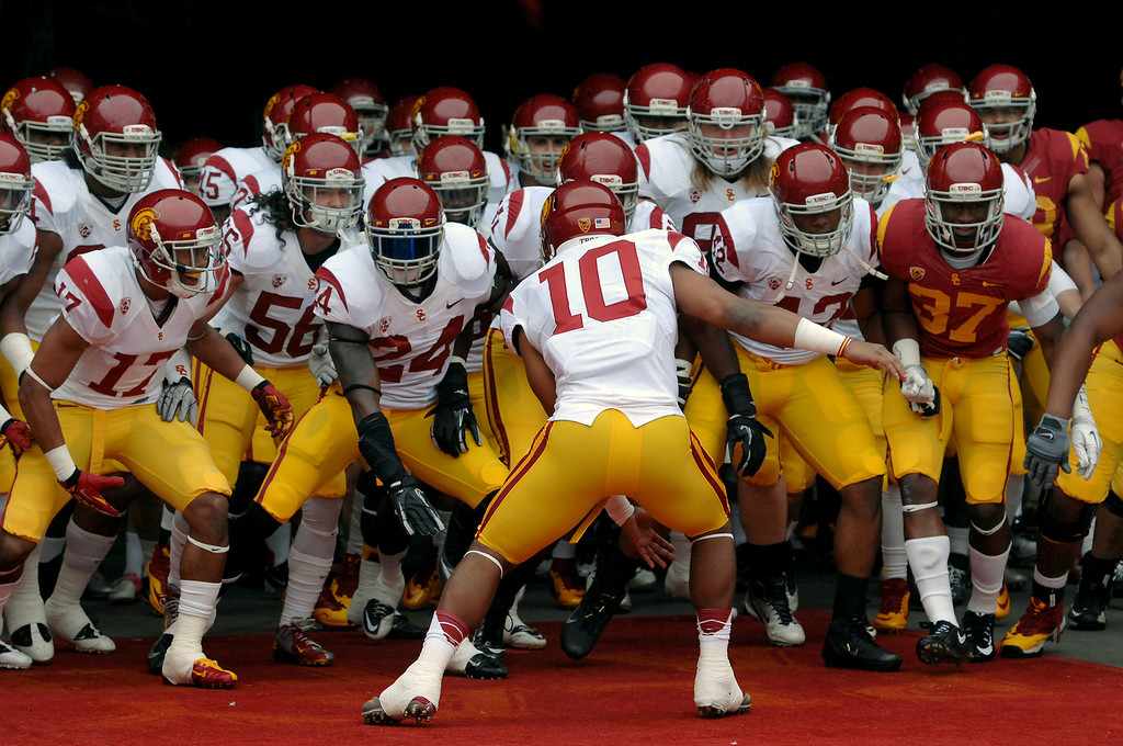 . USC players sway in the tunnel before coming onto the field for their Spring Football Game at the L.A. Memorial Coliseum, Saturday, April 13, 2013. (Michael Owen Baker/Staff Photographer)