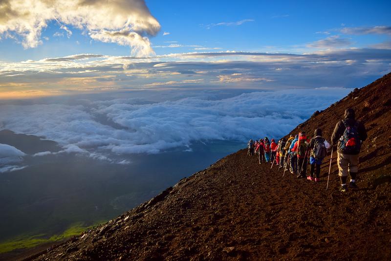 Climbers heading down Mt Fuji. Editorial credit: Nackoper / Shutterstock.com