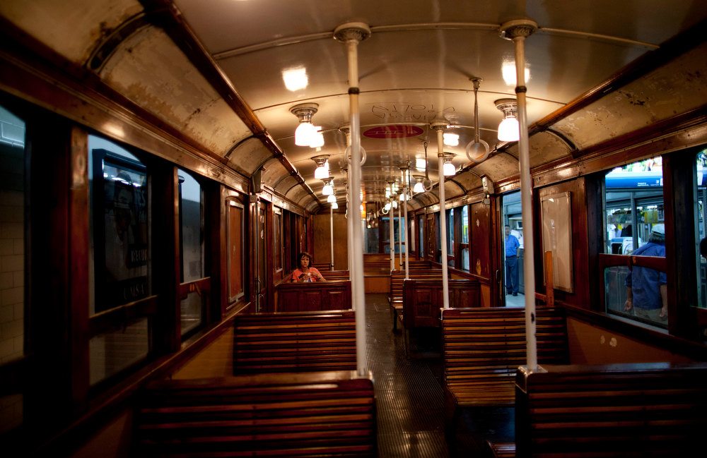 Description of . A lone passenger sits in a wooden carriage car on the historic subway system, Line A, in Buenos Aires, Argentina, Wednesday, Jan. 2, 2013. The city government announced that the almost 100-year-old 'La Brugeoise