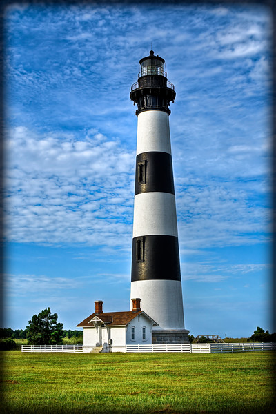 Black and white striped lighthouse in North Caroline near the beach.