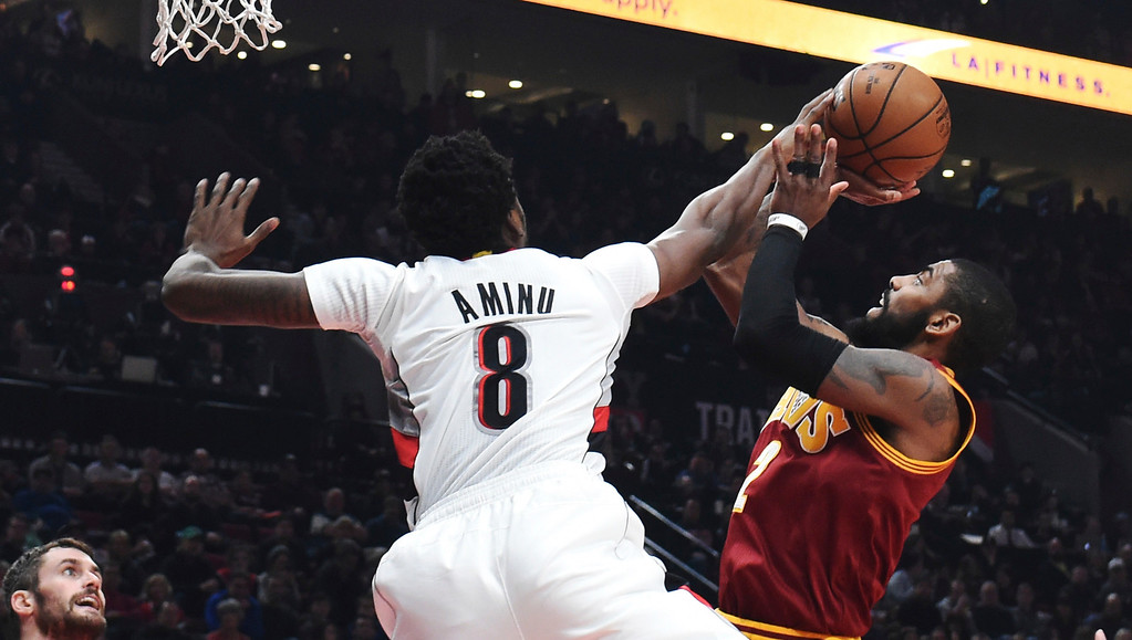 . Portland Trail Blazers forward Al-Farouq Aminu blocks the shot of Cleveland Cavaliers guard Kyrie Irving during the first half of an NBA basketball game in Portland, Ore., Wednesday, Jan. 11, 2017. (AP Photo/Steve Dykes)