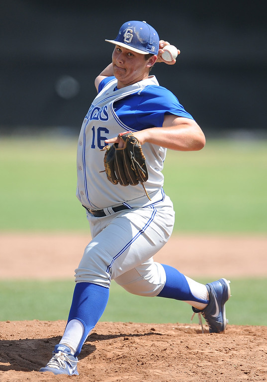 . Charter Oak starting pitcher Nick Hernandez throws to the plate in the first inning of the Championship game of the Gladstone Baseball Tournament against  at Gladstone High School on Wednesday, April 3, 2013 in Covina, Calif. Charter Oak won 5-3. (Keith Birmingham Pasadena Star-News)