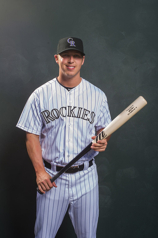 . 6 Corey Dickerson Position: OF Height: 6-1 Weight: 205 Bats/throws: Left/right Expectations: Dickerson, confident in his ability, has hit at every level in which he�s played. He�s aggressive at the plate, on the bases and in the outfield, but he�s still something of a raw defensive player, especially in center field at Coors Field. 2014 salary: $500,000 (Photo by Rob Tringali/Getty Images)