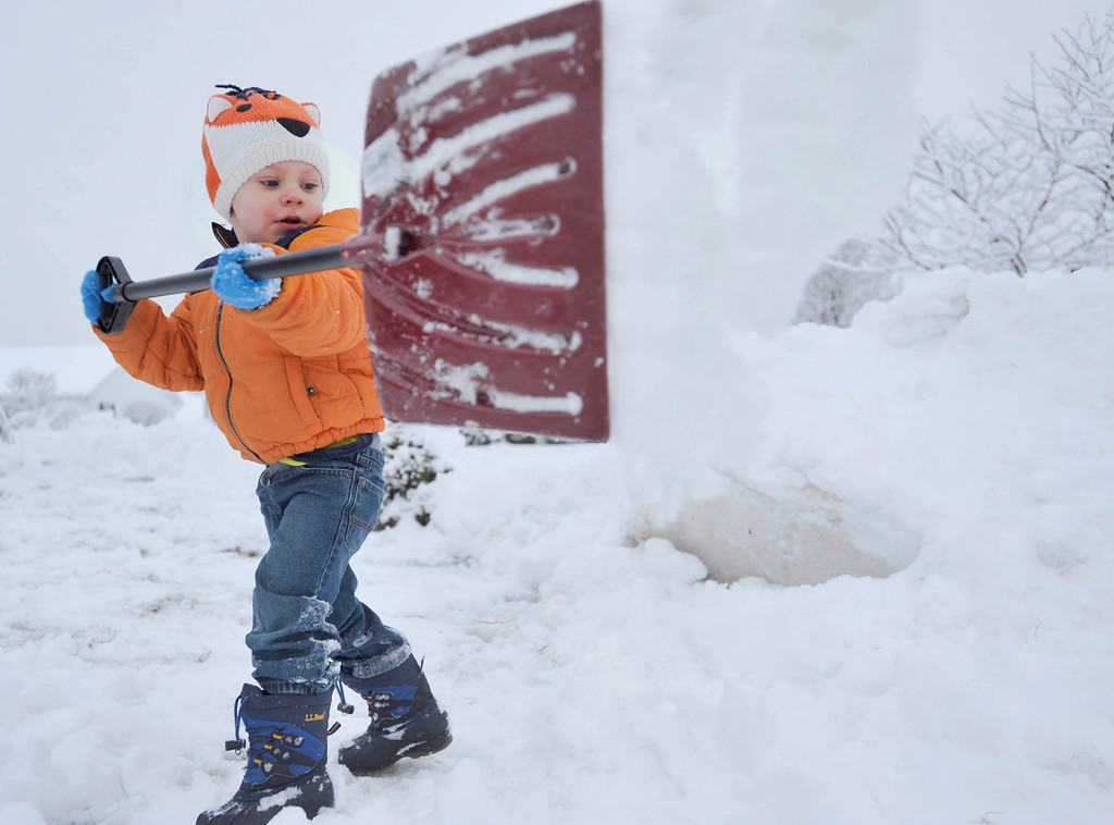 . Owen Renzi, 3, of Windber, Pa. helps his grandparents shovel out their driveway after 5 inches of new snow fell overnight in the Windber area. A potentially historic storm pushed its way up the Philadelphia-to-Boston corridor Monday with what forecasters said could be up to 2 feet of snow. (AP Photo/The Tribune-Democrat, Todd Berkey)