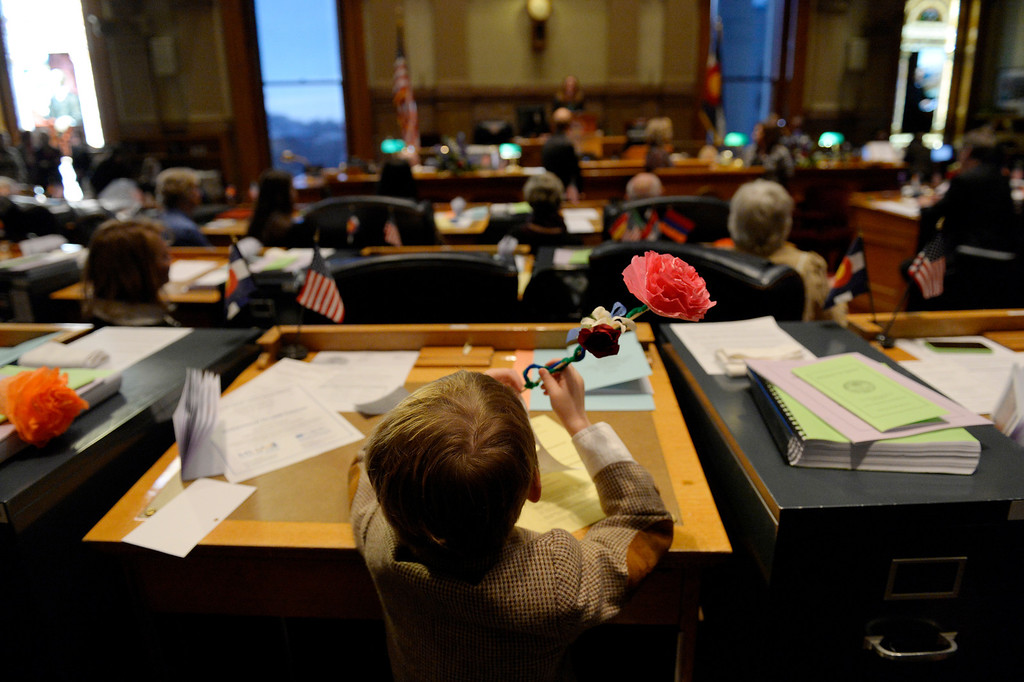 . DENVER, CO. - JANUARY 08: Senator Mike Johnston\'s son, Emmet, 6, sits at his fathers desk during the first day of the new legislative session at the Colorado Capitol in Denver, CO January 08, 2014. (Photo By Craig F. Walker / The Denver Post)