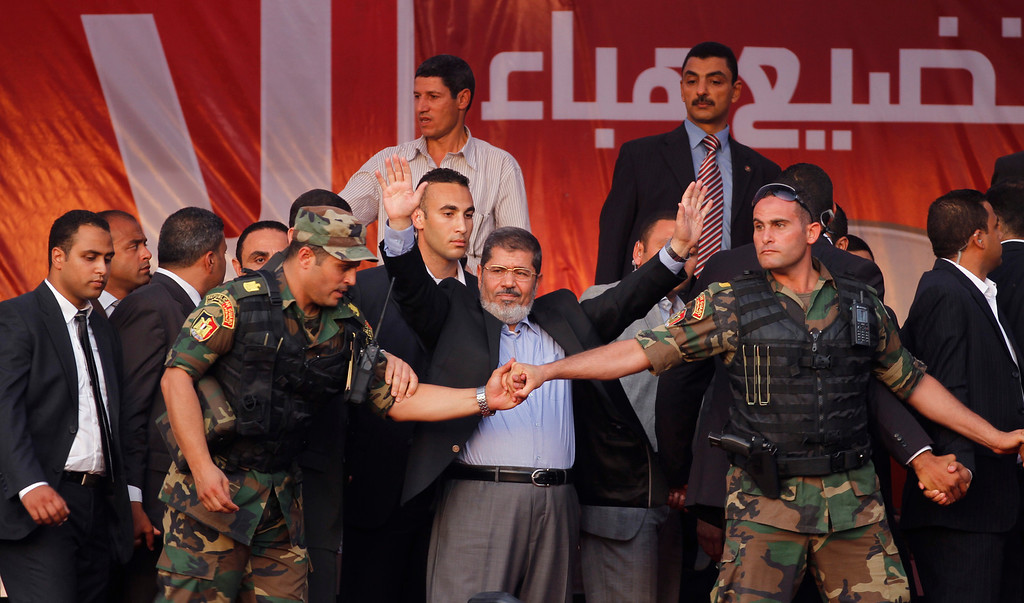 . In this June 29, 2012 file photo, Egypt\'s President-elect Mohammed Morsi waves to supporters after giving a speech at Tahrir Square in Cairo.  (AP Photo/Khalil Hamra, File)