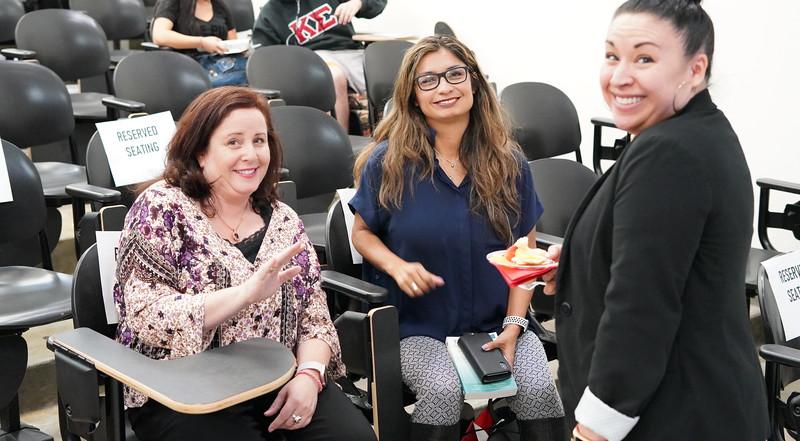 Courtney Carter, Olivia Garcia and Heather Pennella watch the Sonia Nazario presentation